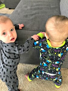 babies learning to stand